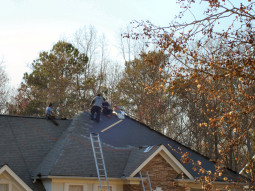March 4, 2009 - Workers on a roof